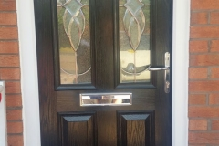 Black Composite door with White PVCu Frames and side panels