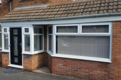 White PVCu Windows and black door front porch