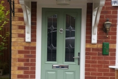 Composite custom designed door with white PVCu frame